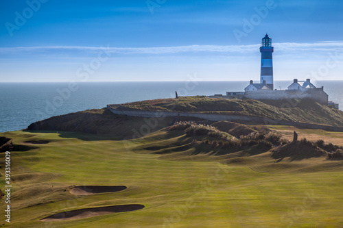 Fototapeta The Lighthouse Overlooking The Old Head Of Kinsale Golf Course In County Cork Ir