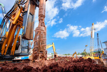 Earth Drilling Machine Or Hydraulic Boring Machine Into A Construction Site For Drilling Piles.