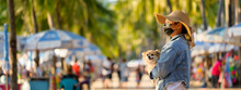 Woman With Small Dog Wearing Surgical Mask For Prevent Coronavirus Outbreak Travel On The Beach