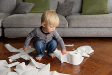 Cute Toddler Making Mess With Toilet Paper In Living Room