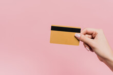 Partial View Of Woman Holding Credit Card In Hand Isolated On Pink