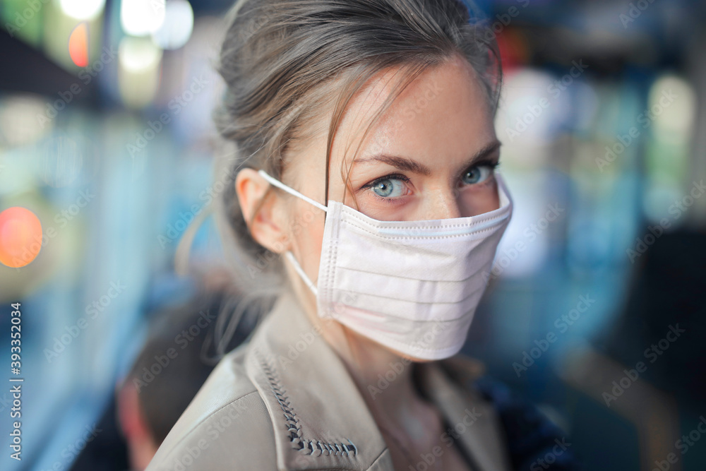 Fototapeta portrait of girl with mask on a bus