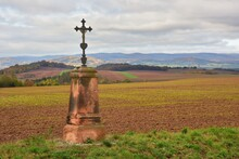 A Wayside Shrine In The Middle Of A Field In Autumn With Beautiful Landscape Behind, Czech Republic.