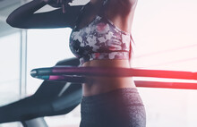 Sporty Woman Is Exercising With Hula Hoop In Fitness Gym For Healthy Lifestyle Concept.
