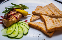 Foie Gras & Toasted Bread For Lunch.Gourmet Duck Liver Mousse Served With Rosemary Herbs In Restaurant.Enjoy Delicious Delicatessen Foods Prepared With Traditonal French Recipe