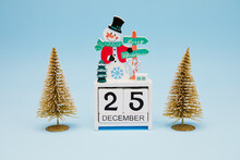 Christmas Decorations And Perpetual Calendar On Blue Background