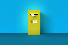 3D Rendered Yellow Mailbox On Blue Background