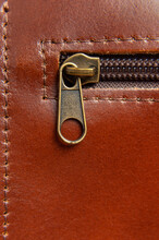 Fashionable Brown Women's Bag Made Of Genuine Leather Close-up. Leather Bag Texture. Fashion Concept Details Of Leather Bag Belt Metal Buckle Clasp Thread Stitching Macro Shot Stylish Female Accessory
