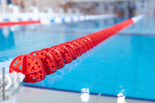 Papel de parede fragment of the competition pool with blue water and marked swimming lanes