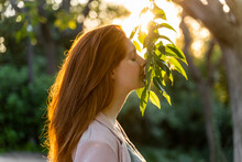 Young Redheaded Woman With Face On Leaves
