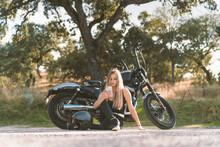 Blond Female Biker Using Smart...