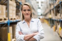 Portrait Of Confident Woman In Factory Storehouse