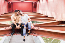 Young Gay Couple In Love Sitti...