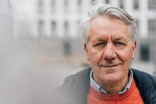 Portrait Of Confident Senior Man Outdoors