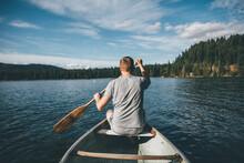 Canada, British Columbia, Man In Canoe On Cultus Lake