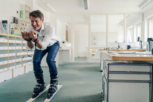 Businessman Skiing In Office