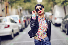 Portrait Of Fashionable Young Woman Wearing Sunglasses And Leather Jacket