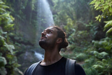 Spain, Canary Islands, La Palma, Close-up Of Bearded Man Near A Waterfall In The Forest