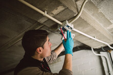 Man Working On An Electrical Installation