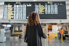 Young Woman Checking Arrival T...