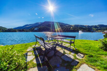 Table And Bench By Lake Against Mountain At Turracher Hoehe, Gurktal Alps, Austria