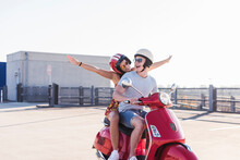 Carefree Young Couple Riding M...