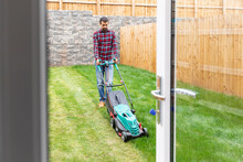 Man Mowing Lawn With Push Lawn...