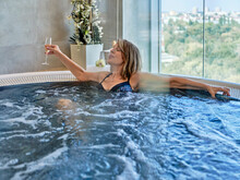 Senior Woman Chilling In Swimming Pool At Health Spa