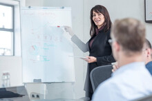 Businesswoman Leading A Presentation On A Meeting In Conference Room