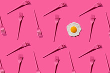 Pattern Of Pink Plastic Forks With Single Fried Egg