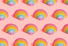 Multiple Image Of Colorful Rainbow Toys On Pink Background