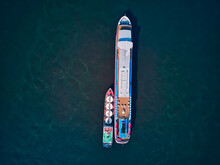 Barge Refueling Recreational Boat On Volga River