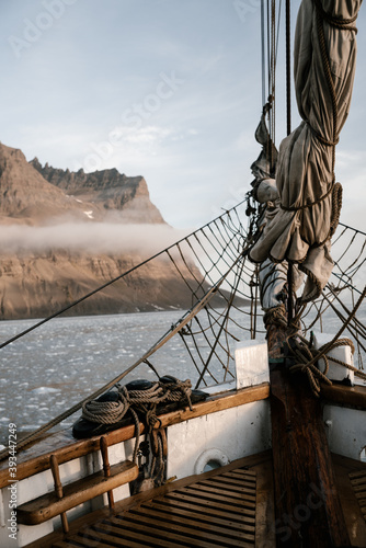 Fotografija View on the rocky greenland coast from the wooden vintage sailboat