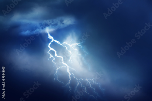 Fotografie, Obraz Lightning in dark cloudy sky during thunderstorm
