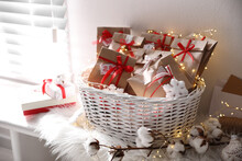 Set Of Gifts In Basket And Christmas Decor On Window Sill Indoors. Advent Calendar