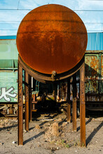 Oxidized Metal Tank Near Train...