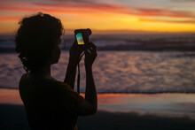 A Girl Make A Photo By Digital...