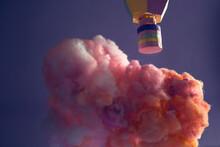 Hot Air Balloon Over A Cloud