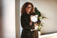Smiling Businesswoman Holding ...