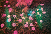 Woman Laying In Grass With Daisies And Daises Body Painted On Her Skin