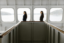 Two Young Women Standing On A ...
