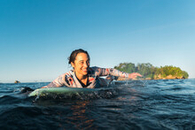 Cheerful Adult Woman Surfer Pa...