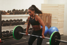Muscular Young Woman Lifting W...