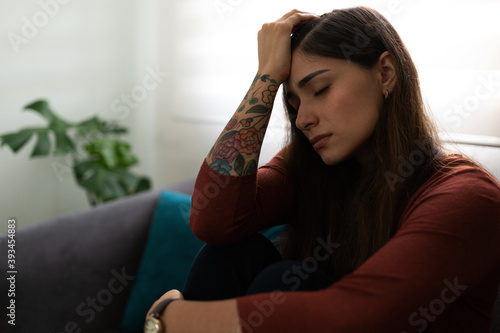 Obraz Side view of a sad and depressed young woman - fototapety do salonu