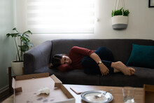 Sick Woman Crying With Pain On The Couch