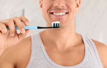 Man Holding Toothbrush With Pa...