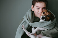 Happy Young Boy With Cute Dog.