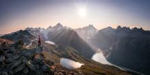 Female Alpinist In Epic Mounta...
