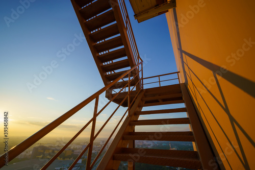 Tablou Canvas Fire escape on the yellow building wall, Outside fire escape stairs