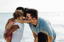 Loving Parents And Kids Near Sea